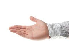 рука дела держа вне рубашку молодой Стоковые Изображения RF