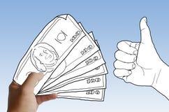Рука держа деньги Стоковые Фото