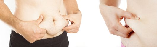 Рука держа живот тучный стоковая фотография rf