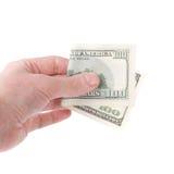 Рука держа 100 счетов доллара. Стоковая Фотография