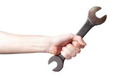 Рука держит гаечный ключа Стоковое Фото
