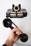 рука держит пробку телефона Стоковая Фотография RF