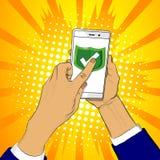 Рука держит умный телефон с зеленым экраном и палец касается экрану бесплатная иллюстрация