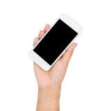Рука девушки держа мобильный телефон изолированный на белизне Стоковые Фото