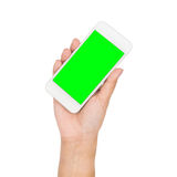Рука девушки держа мобильный телефон при зеленый экран изолированный на белизне Стоковая Фотография