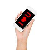 Рука девушки держа слово дисплея мобильного телефона я тебя люблю на экране Стоковые Изображения RF