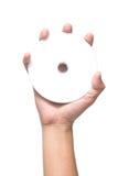 Рука держа белый пустой КОМПАКТНЫЙ ДИСК DVD Стоковые Изображения RF