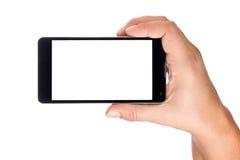 Рука держа большой современный Smartphone Стоковое фото RF