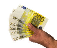 Рука держа деньги - деньги евро наличные деньги евро отсутствие предпосылки Банкноты денег евро Стоковые Изображения