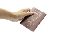 Рука держа книгу пасспорта Стоковые Фото