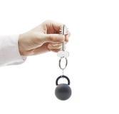 Рука держа ключ Стоковое Фото