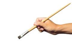 Рука держа малый paintbrush Стоковая Фотография RF