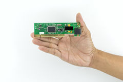 Рука держа обломок IC Стоковое Изображение RF