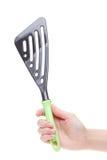 Рука держа лопату для сковороды Стоковое фото RF