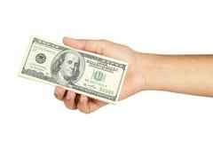 Рука держа 100 долларовых банкнот Стоковые Изображения