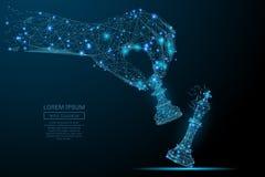 Рука держа поли пешки шахмат голубое низкое Стоковое Фото