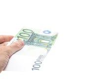 Рука держа 100 примечаний евро Стоковая Фотография RF