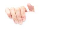 Рука держа пустую белую бумагу для рекламирует текст стоковая фотография