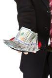 Рука держа плиту с долларами стоковая фотография rf