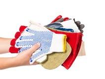 Рука держа различные резиновые перчатки Стоковые Фото