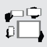Рука держа современный прибор Стоковая Фотография