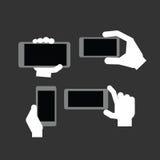 Рука держа современный прибор Стоковая Фотография RF