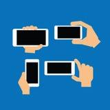 Рука держа современный прибор Стоковое Фото