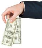 Рука держа 100 счетов доллара Стоковое Фото
