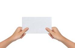 Рука держа чистый лист бумаги Стоковые Фотографии RF
