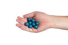 Рука держа шарики краски Стоковые Изображения RF