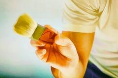 Рука держа щетку картины Стоковое Изображение