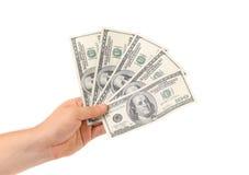 Рука держит американские долларовые банкноты Стоковое Изображение