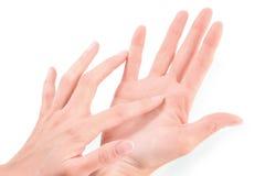 Рука женской руки касающая Стоковые Фото