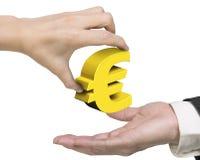 Рука женщины давая золотой символ евро к руке человека Стоковые Фотографии RF
