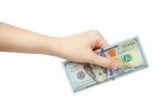 Рука женщины давая 100 долларов изолированных на белой предпосылке Стоковые Изображения RF