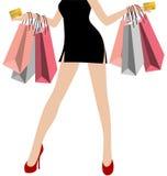 Рука женщины в черных мини платьях с много красочная хозяйственная сумка Стоковая Фотография
