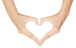 Рука женщины делая сердце знака Стоковые Изображения RF