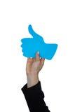Рука женщины держа большие пальцы руки поднимает доску знака Стоковые Фотографии RF