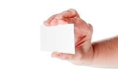 Рука женщины держа чистый лист бумаги Стоковая Фотография