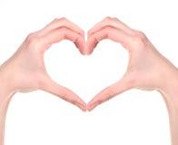 Рука женщины делая сердце знака Стоковые Изображения
