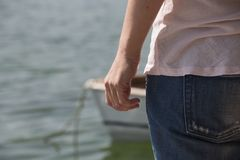 Рука женщины от задней части Стоковые Фото