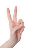 Рука женщины показывая номер два или изолированный жест победы Стоковые Изображения RF