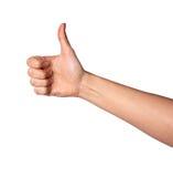 Рука женщины при большой пец руки вверх изолированный на белой предпосылке Стоковое Изображение