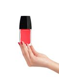 Рука женщины при красный маникюр изолированный на белизне Стоковая Фотография RF