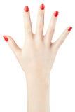 Рука женщины при красный маникюр поднятый вверх Стоковое Фото
