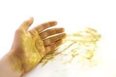 Рука женщины со сверкнает стоковое изображение rf