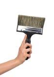 Рука женщины с кистью с пластичной черной ручкой i Стоковые Фотографии RF