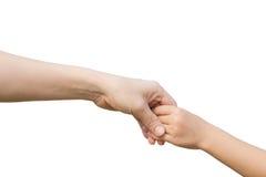 Рука женщины тщательно держит девушку Стоковая Фотография