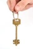 рука золота держит ключа Стоковое Изображение RF