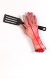 Рука зомби с шпателем, флиппером, лопатой сковороды стоковая фотография